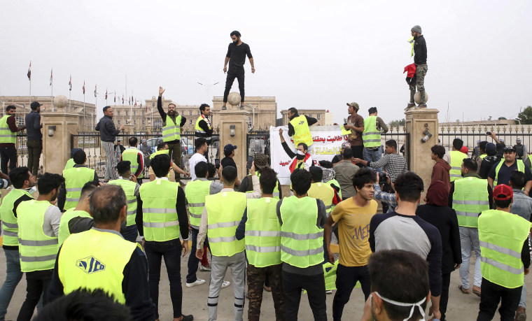 Image: Protesters chant slogans in front of the provincial council building during a demonstration demanding better public services and jobs in Basra, southeast of Baghdad, Iraq