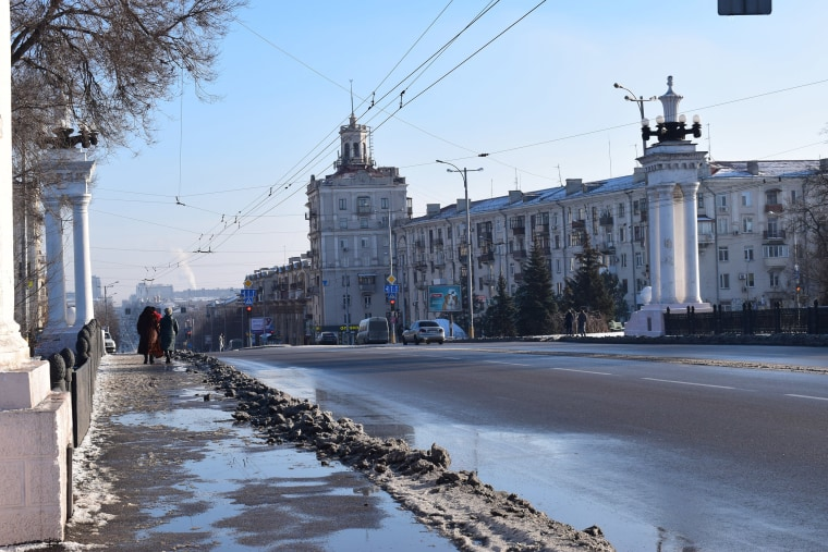 Image: Residents walk along Prospect Soborniy, Zaporizhzhia's main street, the Sunday after martial law was introduced.