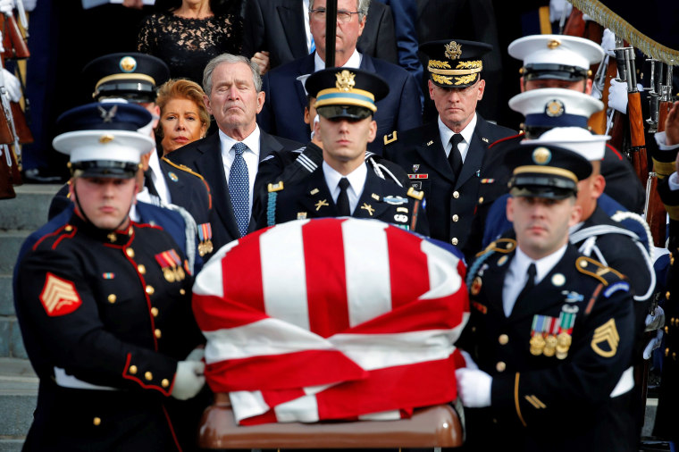 Image: Former U.S. President George W. Bush follows behind honor guard carrying casket of George H.W. Bush at Washington National Cathedral
