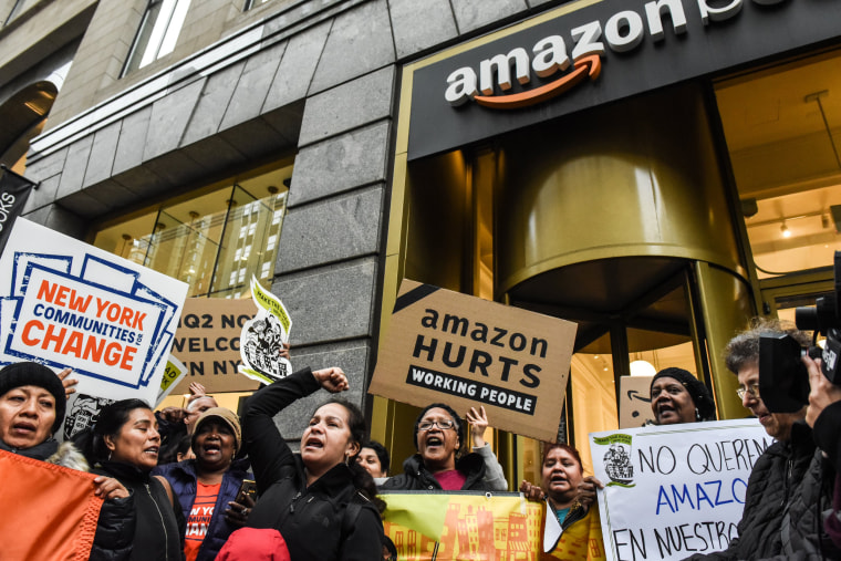 Image: Protesters opposing Amazon's plan to build a headquarters in New York hold a protest outside of an Amazon book store on in Manhattan on Nov. 26, 2018.
