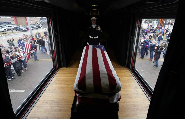 Image: The casket of former President George H.W. Bush passes through Magnolia, Texas.