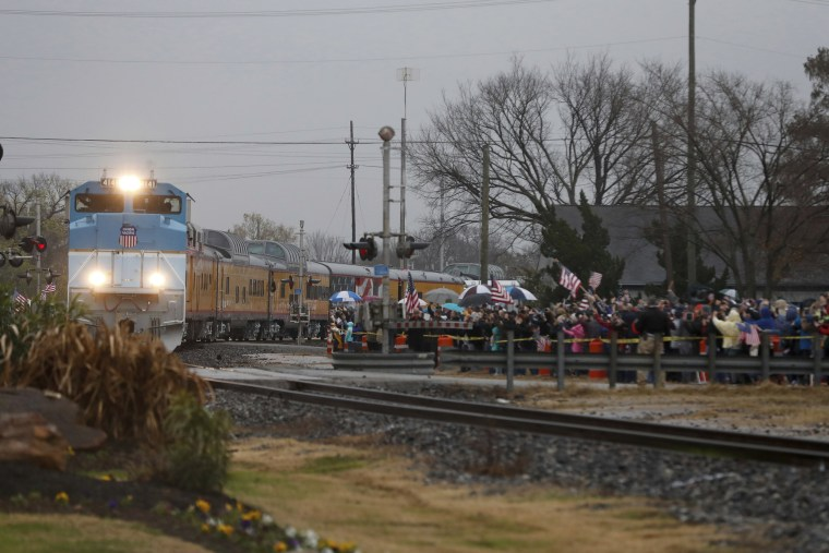 Image: The train carry the casket of President George H.W. Bush passes through Navasota, Texas.