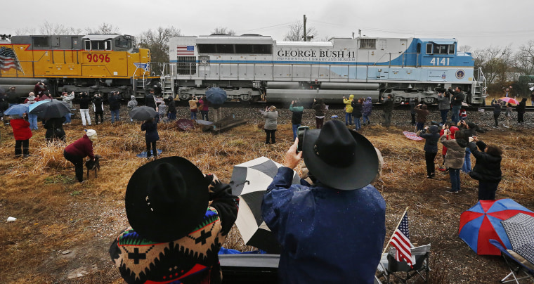 Image: Tim and Jean O'Neal watch from the back of their pickup as the train passes through Millican, Texas.