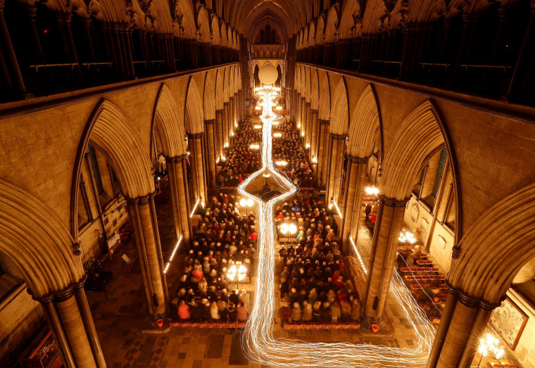 """Image: Salisbury Cathedral celebrates the beginning of Advent with a candle-lit service and procession, \""""From Darkness to Light\"""