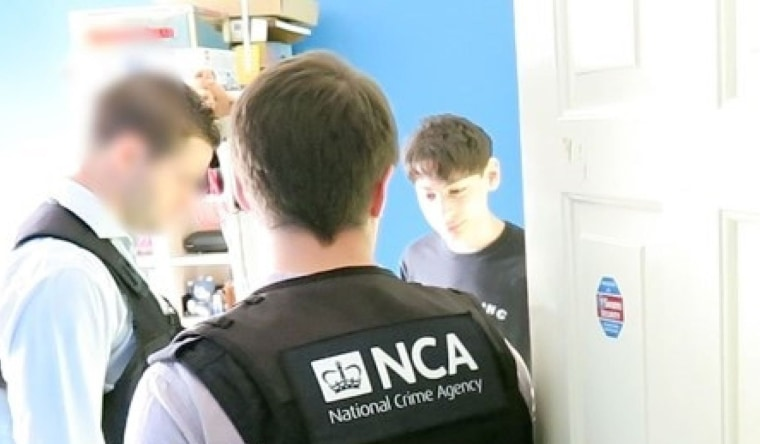 Image: George Duke-Cohan speaks to National Crime Agency officers during his arrest.