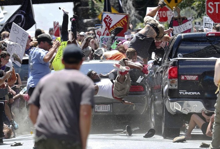 Image: People fly into the air as a vehicle drives into a group of protesters