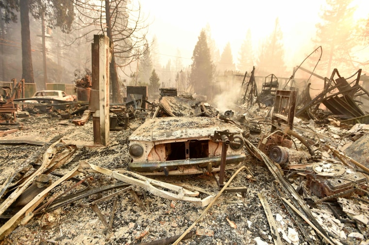 The remains of a burned vehicle outside of a home in Paradise, California.