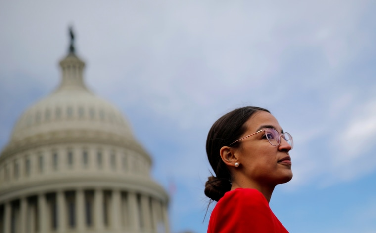 Image: Democratic Representative-elect Alexandria Ocasio-Cortez of New York arrives for a class photo with incoming newly-elected members of the U.S. House of Representatives on Capitol Hill in Washington, U.S.