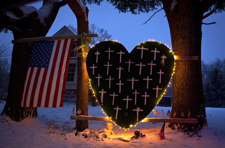 Image: A heart bearing 26 crosses, one for each victim of the Sandy Hook massacre