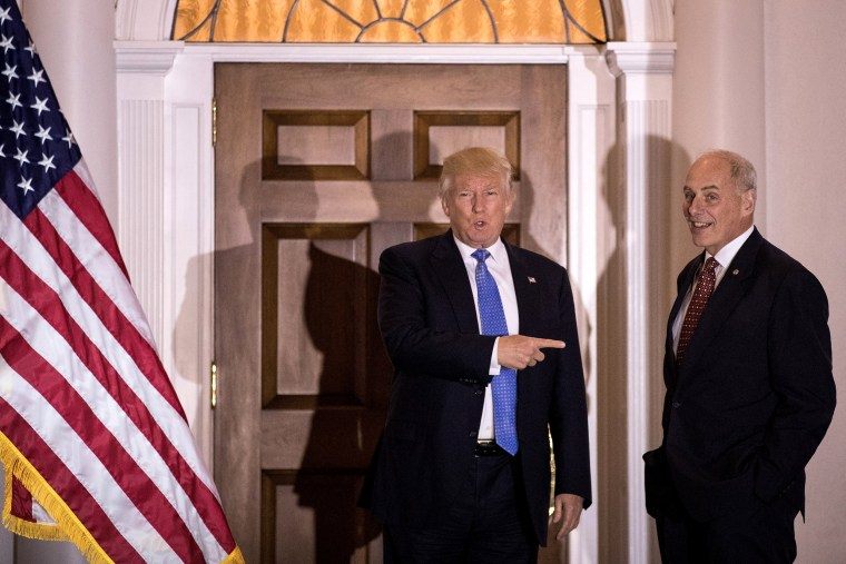 Image: Donald Trump points at John Kelly before their meeting at Trump International Golf Club in Bedminster, New Jersey, on Nov. 20, 2016.