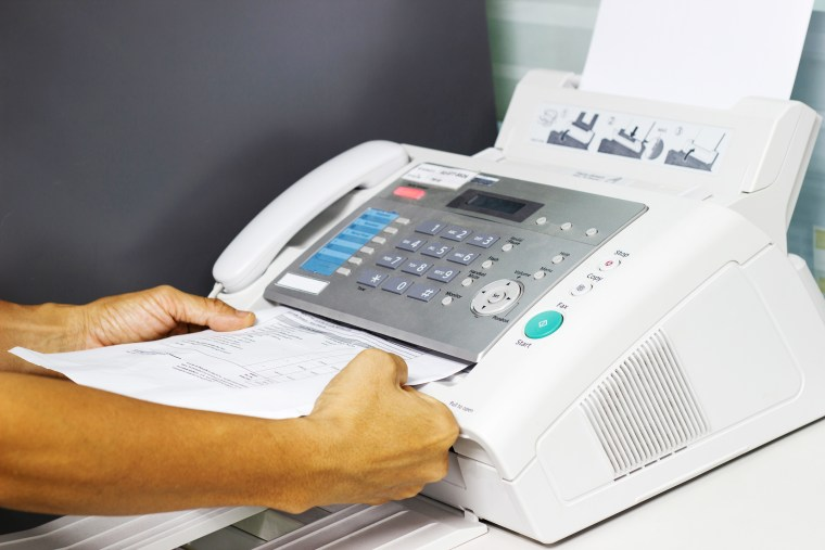 Fax machines continue to be used in offices around the world