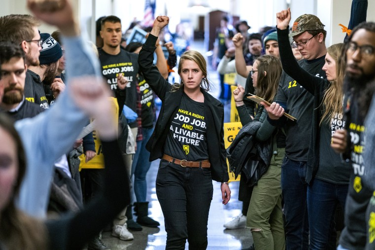 "Image: Supporters of the ""Green New Deal"" rally inside the Longworth House Office Building in Washington on Dec. 10, 2018."