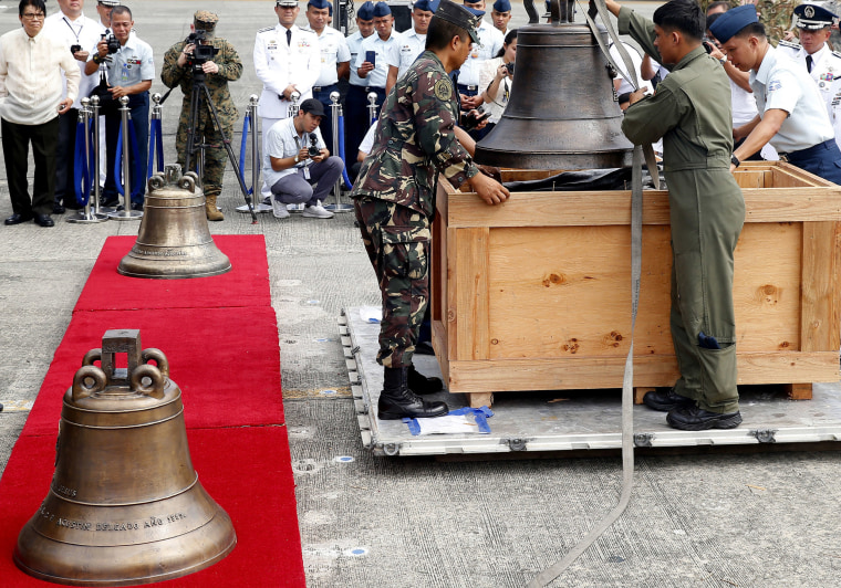 Image: Philippine military personnel unload the three church bells