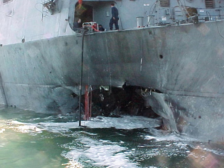 Image: The damaged port side of the guided missile destroyer USS Cole after an attack blamed on the al-Qaeda terror network