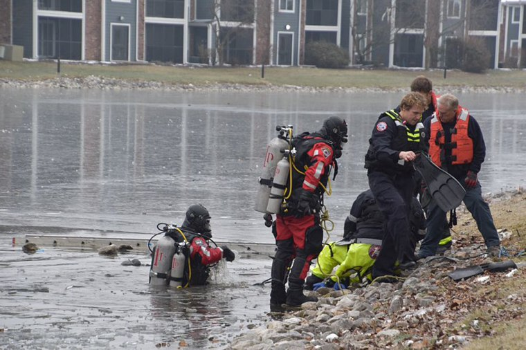 Indiana Fire Department Divers dove into a retention pond at The Masters Apartment Complex in Indianapolis after witnesses say he ran after his dog who had run onto pond on Dec. 10, 2018.