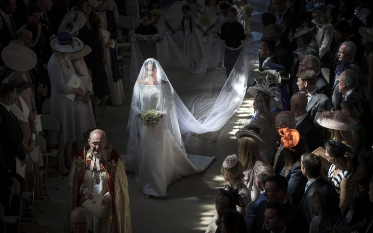 Image: Meghan Markle walks down the aisle in St George's Chapel in Windsor on May 19, 2018.
