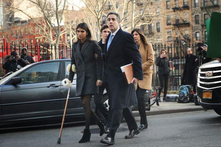 Image: Michael Cohen walks to federal court with his children and wife in Manhattan on Dec. 12, 2018.