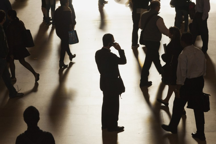 Image: A man stands in Grand Central Terminal as he speaks on a cell phone in New York in 2013.