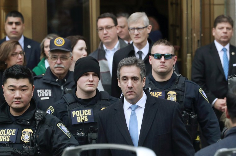 Michael Cohen exits the courthouse after his sentencing in New York