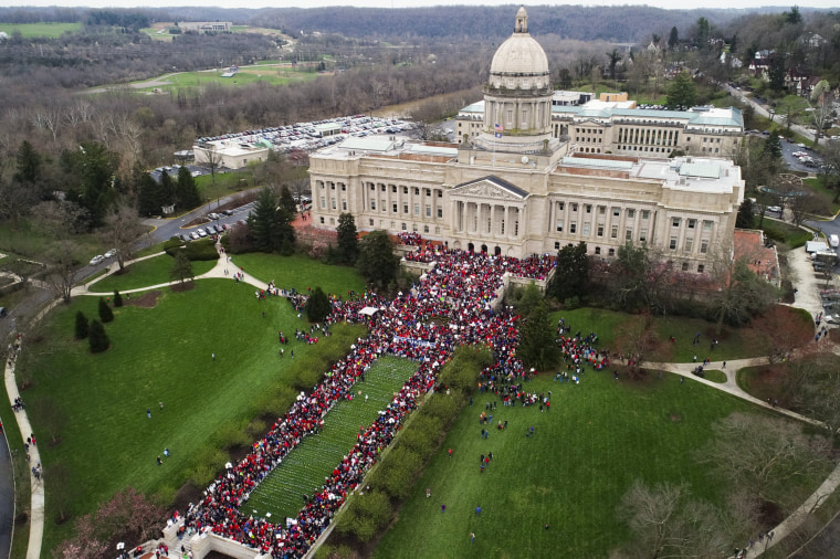 Image: Thousands of teachers gather during a rally for education funding and changes to their pension system at the state Capitol in Frankfort, Kentucky, on April 2, 2018.