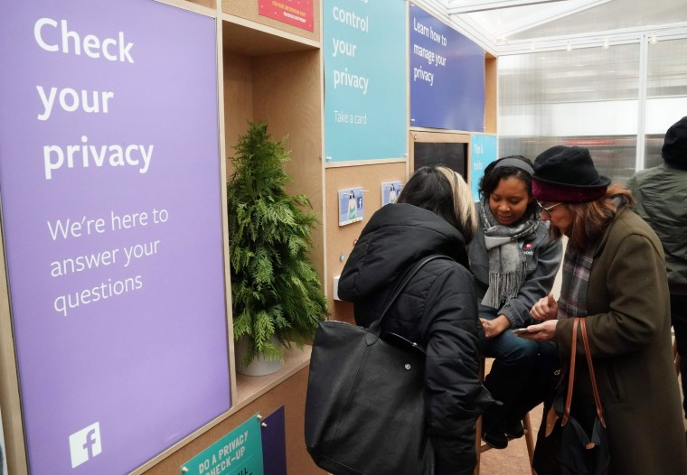 """Facebook employees talk to visitors at """"Privacy Pop-Up"""" kiosk in Bryant Park in New York on Dec. 13, 2018."""