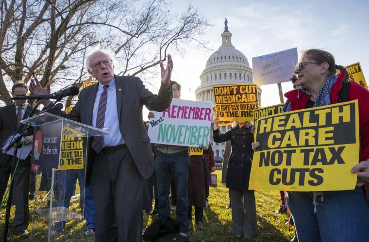 Image: Sen. Bernie Sanders joins protesters outside the Capitol as Republicans in the Senate work to pass a tax bill on Nov. 30, 2017.