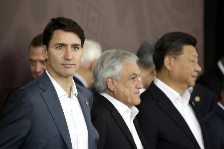 Image: Canadian Prime Minister Justin Trudeau, Chile's President Sebastian Pinera, and Chinese President Xi Jinping