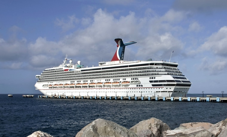 Image: Tourists board the Carnival Victory cruise ship at Port Sante in Basseterre, Saint Kitts and Nevis, in 2009.