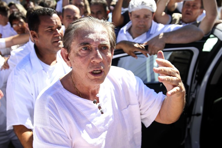 """Spiritual healer Joao Teixeira de Faria, also known as """"John of God,"""" turned himself in to authorities Sunday in Brazil."""