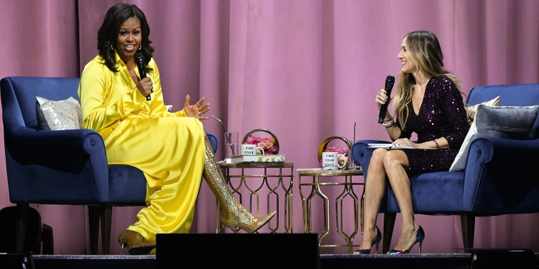 Michelle Obama rocks glittery boots during a stop on her 'Becoming' book tour.