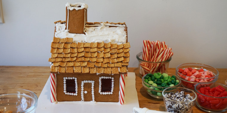 Shingle the roof of your gingerbread house with cereal, sliced almonds or sour strips of candy.