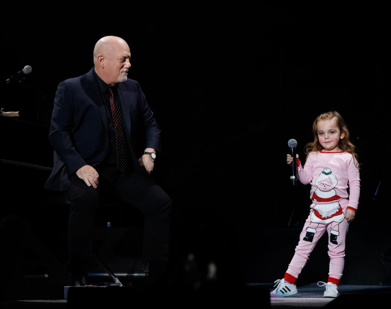 Billy Joel's daughters Della Rose and Alexa Ray join dad onstage