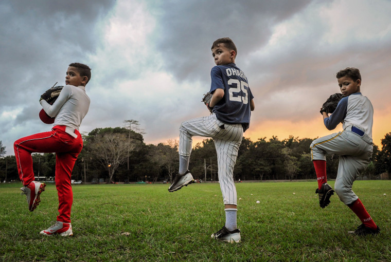 Image: Cuban children train during a baseball practice in Havana