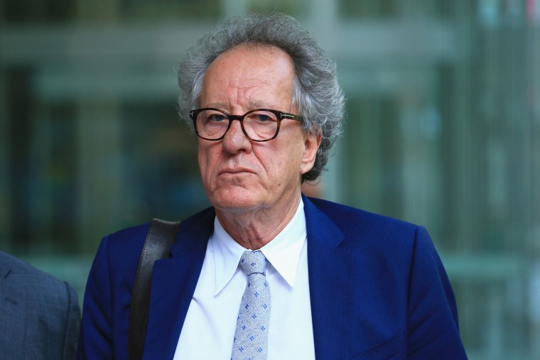 Image: Actor Geoffrey Rush leaves the Federal Court in Sydney