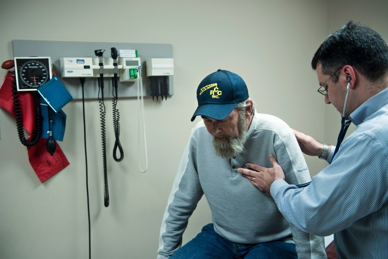 A lung cancer survivor is examined by a doctor at the Clay-Battelle Community Health Center in Blacksville, West Virginia, on March 21, 2017 .