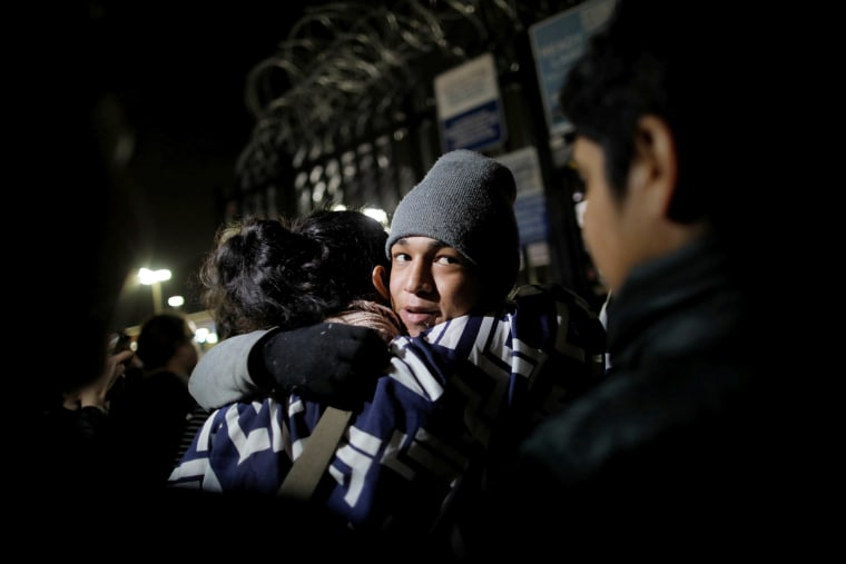 Image: An unaccompanied minor, part of a caravan of thousands from Central America, reacts as he is allowed to enter the United States to apply for asylum at the Otay Mesa port of entry on Dec. 17, 2018.
