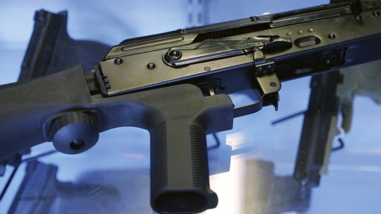 Image: A bump stock is attached to a semi-automatic rifle at store and gun range in South Jordan, Utah, on Oct. 4, 2017.