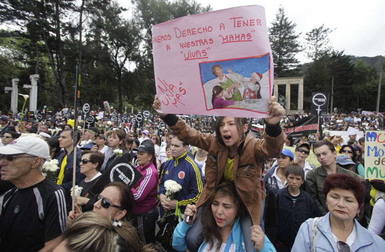 "Image: A girl holds a sign that says ""We have the right to have our moms alive"" during a rally to protest the rape and murder of Rosa Elvira Cely at the National Park in Bogota, Colombia, on June 3, 2012."