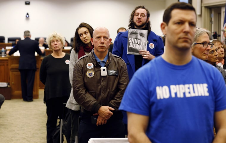 Image: Pipeline opponents turn their backs on an air pollution panel as they delay a key vote on the Atlantic Coast Pipeline in Richmond, Virginia, on Dec. 19, 2018.