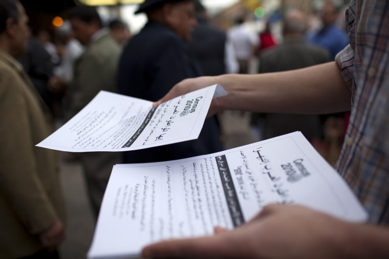 Image: Men take fliers encouraging the Arab population to fill out their 2010 Census forms in Bay Ridge, New York, on April 9, 2010.
