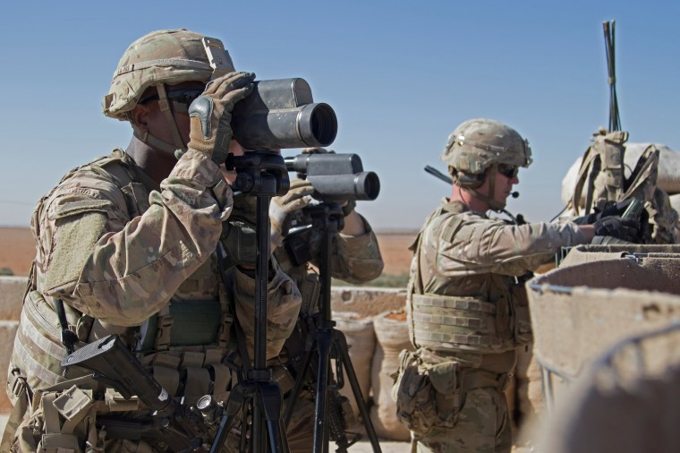 Image: U.S. Soldiers surveil the area during a combined joint patrol in Manbij