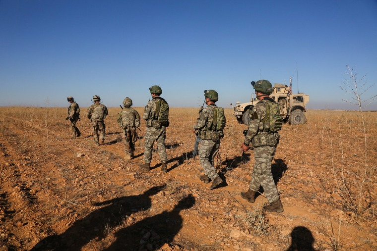 Image: U.S. and Turkish soldiers conduct the first-ever combined joint patrol outside Manbij