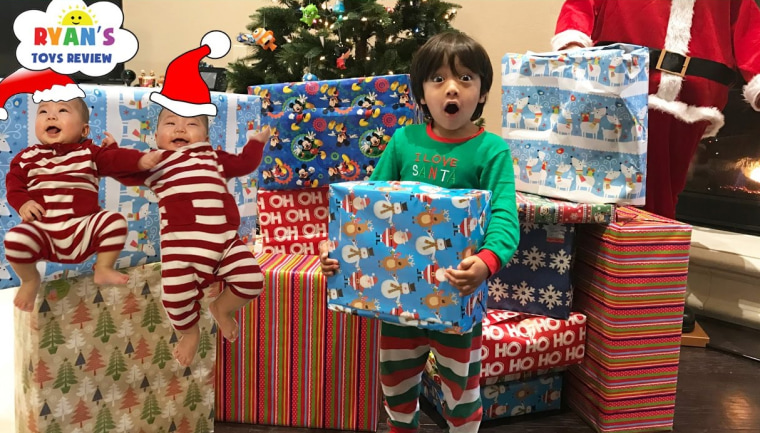 Image: Ryan from Ryan's ToysReview opens Christmas presents in 2016.