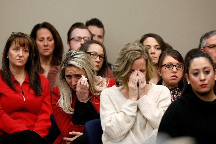 Image: Victims and supporters look on as Rachael Denhollander speaks at the sentencing hearing for Larry Nassar in Lansing, Michigan, on Jan. 24, 2018.