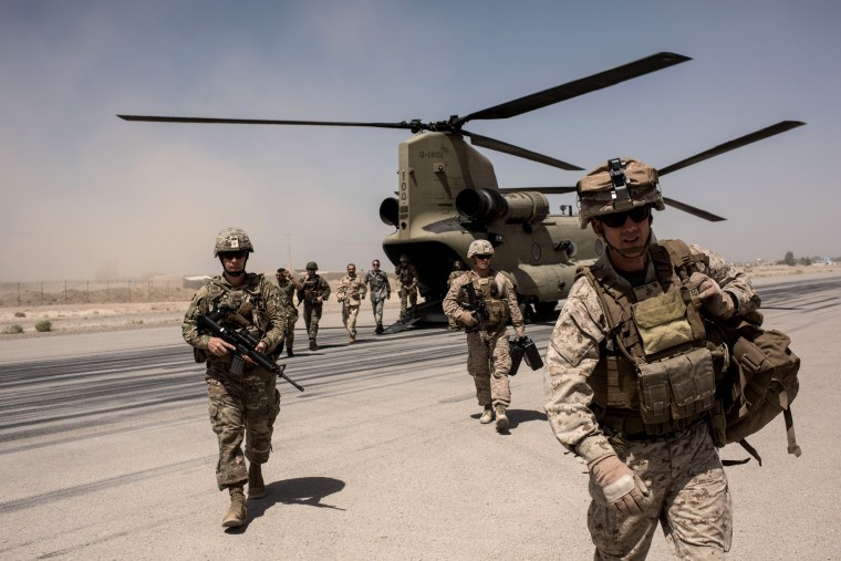 Image: U.S. troops walk off a helicopter at Camp Bost in Helmand Province, Afghanistan, on Sept. 11, 2017.