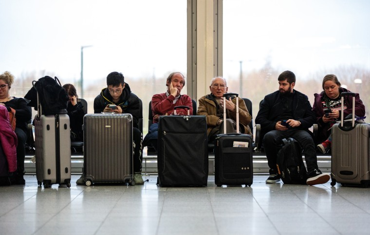 Image: Passengers wait in the South Terminal building at London's Gatwick Airport after flights resumed on Dec. 21, 2018.