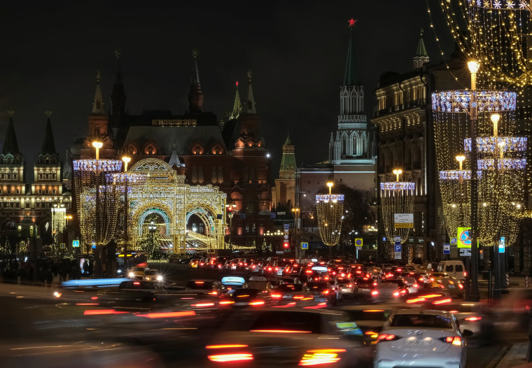 Image: Traffic moves along Tverskaya street which is decorated with lights for the New Year and Christmas season in Moscow