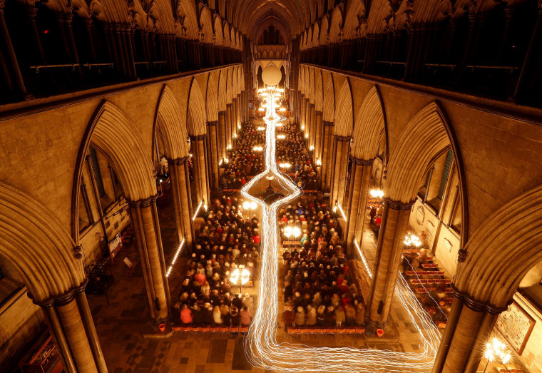 """Image: Salisbury Cathedral celebrates the beginning of Advent with a candle-lit service and procession, """"From Darkness to Light\"""