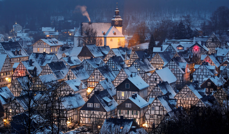 """Image: Snow covers the roofs of the so-called \""""Alter Flecken\"""" (old spot), the historic core of downtown Freudenberg"""