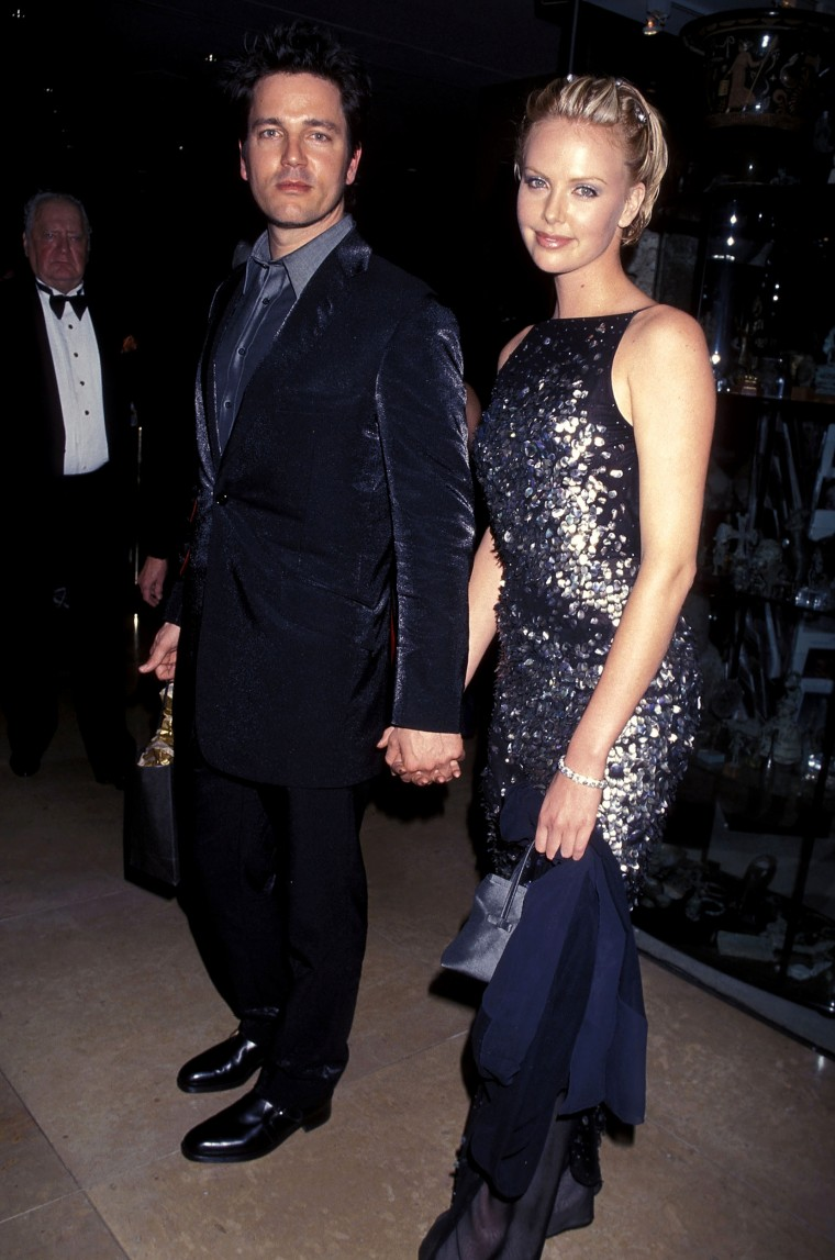 Musician Stephan Jenkins of Third Eye Blind and actress Charlize Theron attend the 56th Annual Golden Globe Awards After Party Hosted by Miramax Films on January 24, 1999 at Beverly Hilton Hotel in Beverly Hills, California. (Photo by Ron Galella, Ltd./WireImage)